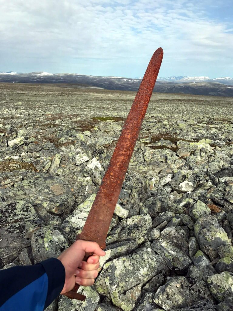 The finder holding the Viking sword without gloves