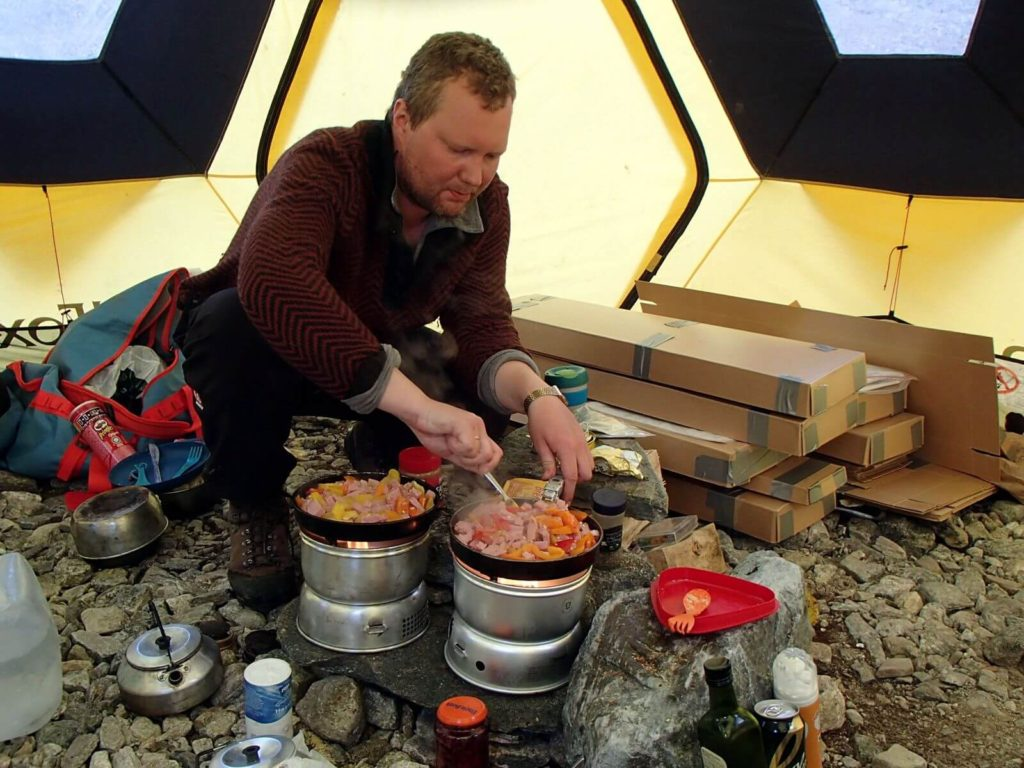 Runar preparing dinner in the mess tent.