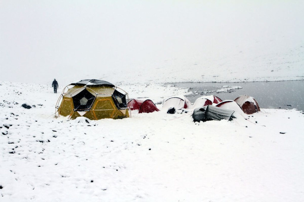 The Lendbreen basecamp during a snow blizzard in August 2013.