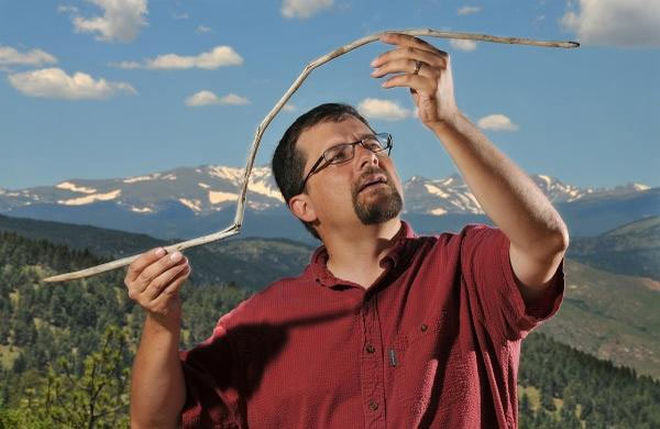 Craig Lee holding a dart for an atlatl.