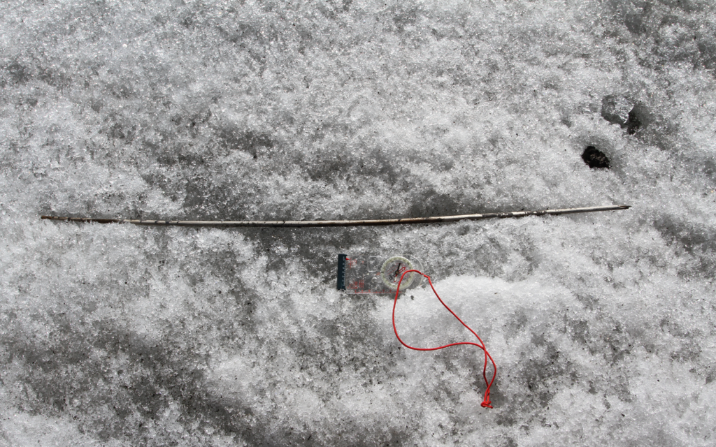 A four thousand years old wooden arrowshaft, found on the ice surface in Jotunheimen in 2014, when melting reached old ice.