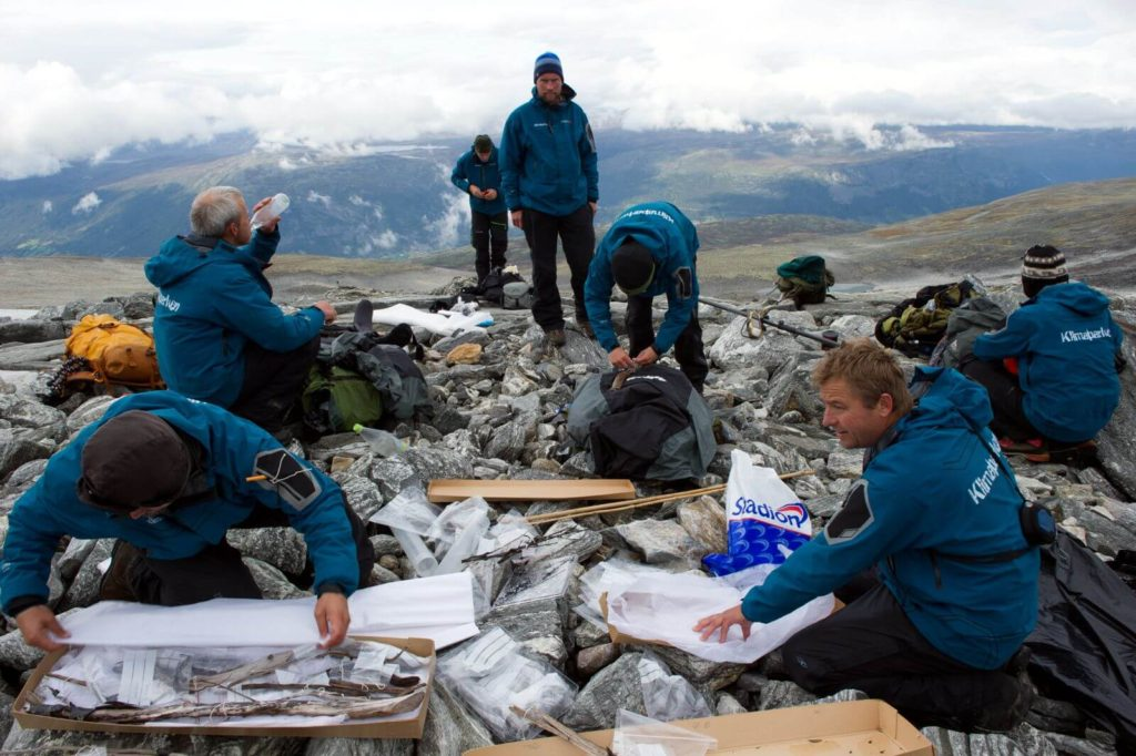 Archaeologists packing finds in the Lendbreen pass.