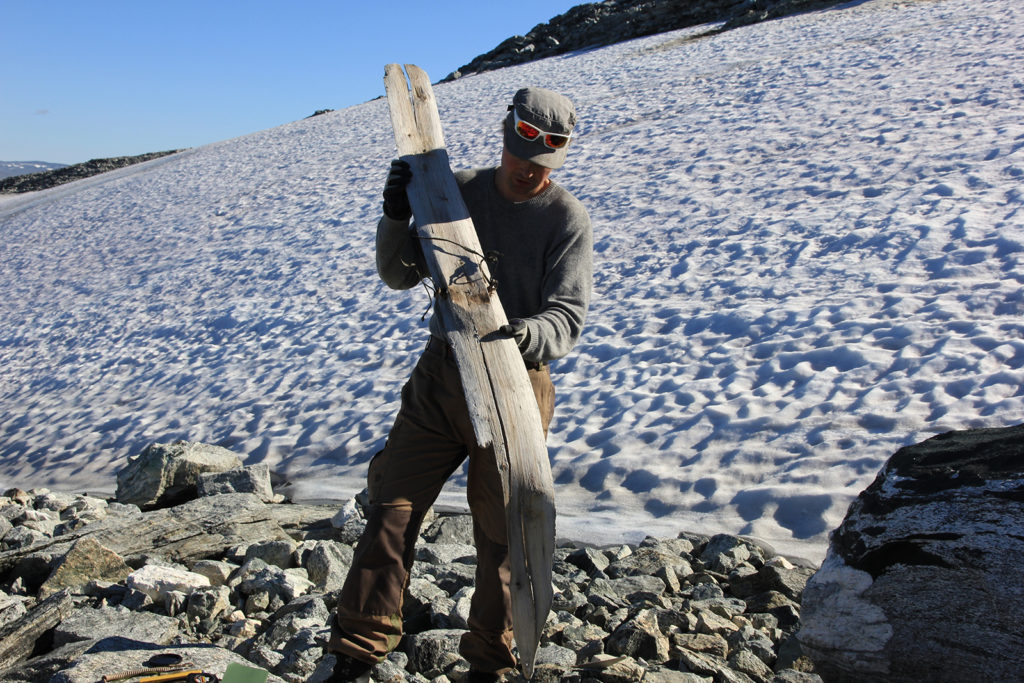 Runar Hole holding one of the skis from the glacial ice.