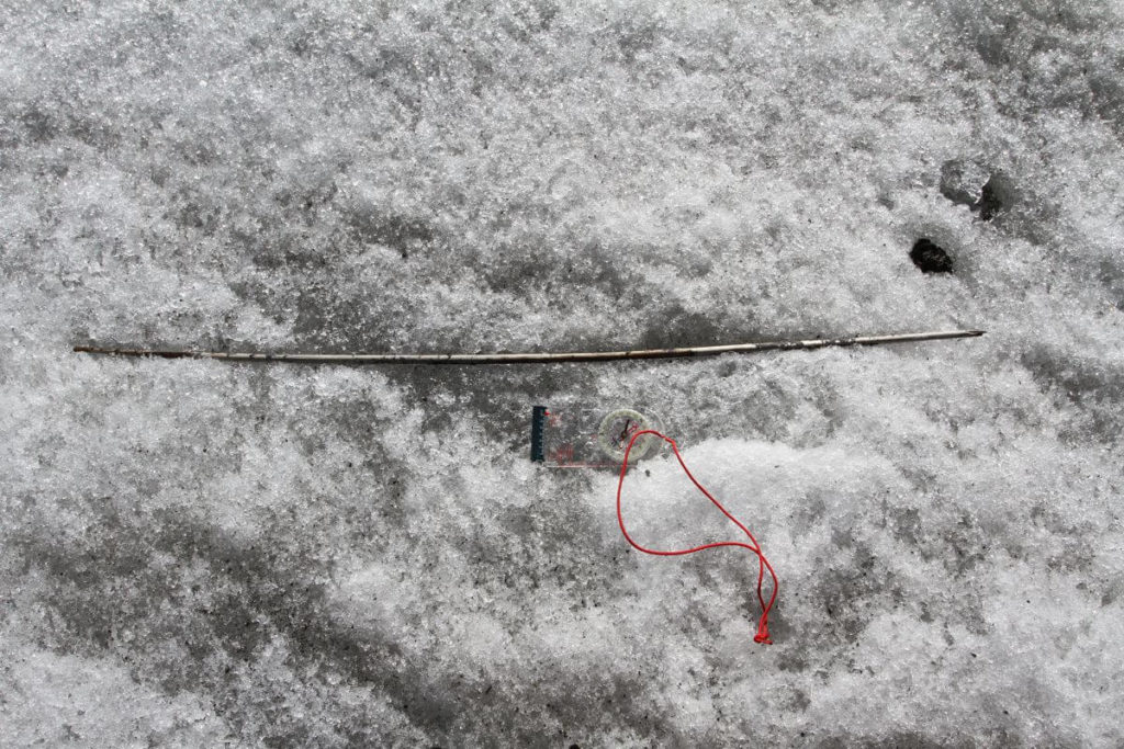A 4000-year-old arrow lying on the ice.