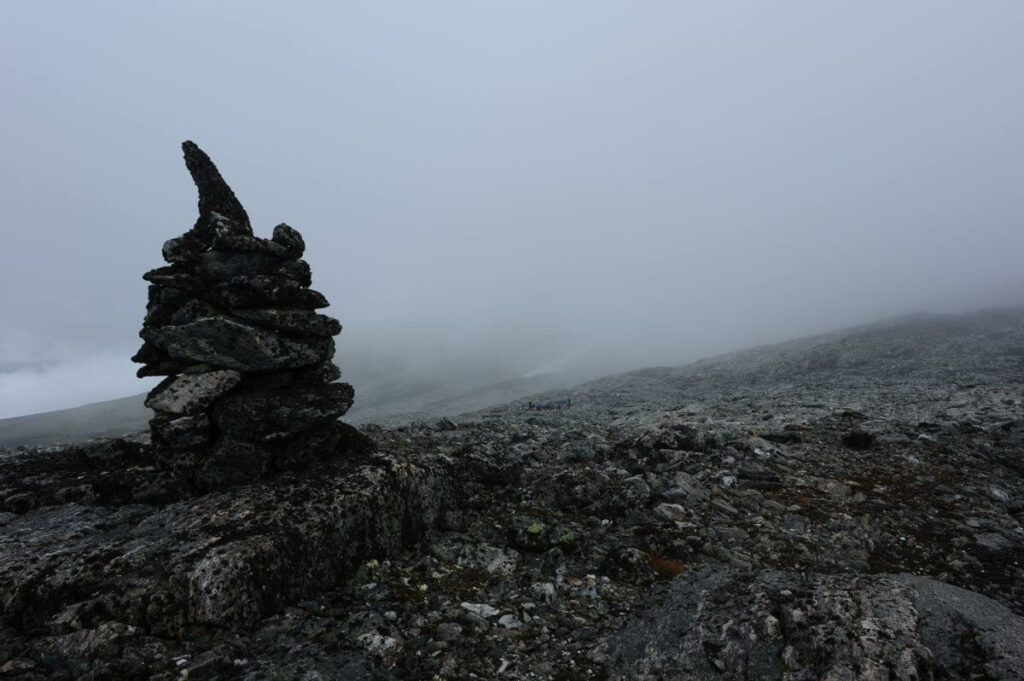 A karge cairn in the fog.